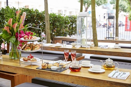 Breakfast, brunch of high tea at Cafe Forty One With platters of sandwiches and champagne flutes