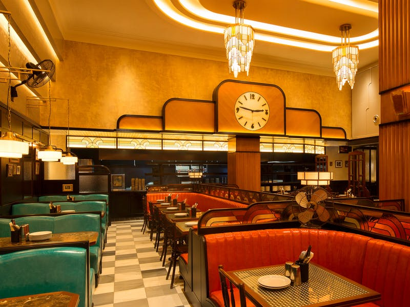 Interior of Dishoom with American-diner style booths and check floor