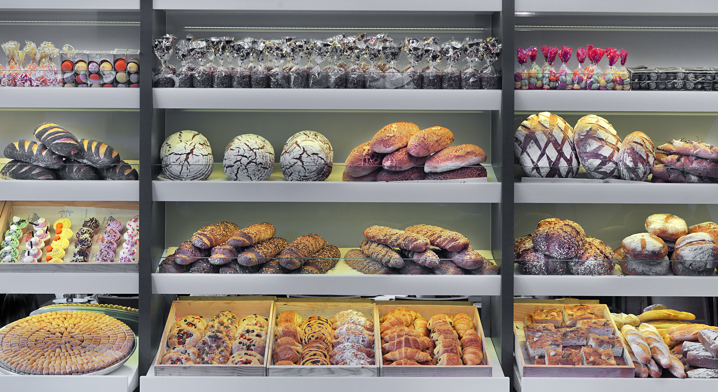 Picture of breads and pastries in a bakery display case