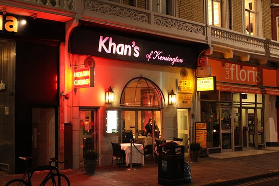 Picture of the exterior and sign of Khan's of Kensington lit up with neon lights